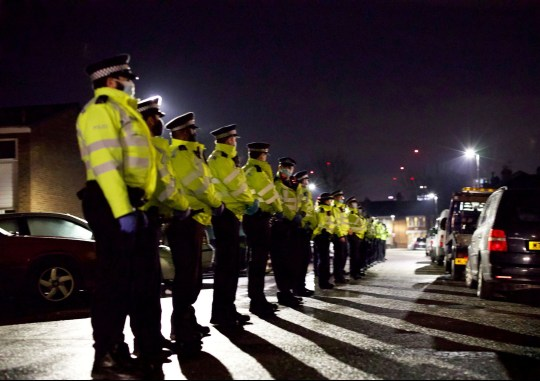The Met lined up while wearing masks. Police tried to disperse 'travellers' who allegedly flouted coronavirus rules and gathered for a wake at a caravan park in Seven Sisters, London.