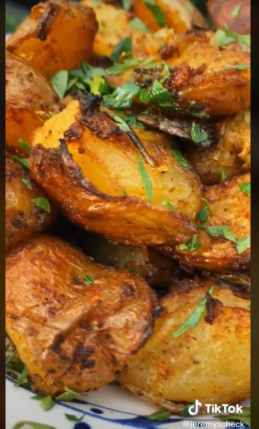 a still from a video showing how to make the perfect roast potatoes