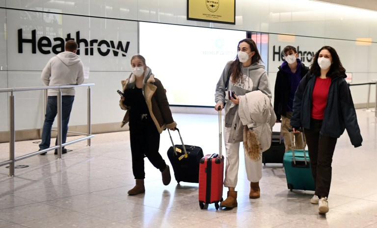 epa08941379 Travellers arrive at Heathrow Airport in London, Britain, 16 January 2021. The UK government is implementing a closure on all travel corridors from Monday 18 January 2021. Travellers will also need to provide a negative coronavirus test to enter the country. Britain's national health service (NHS) is coming under sever pressure as Covid-19 hospital admissions continue to rise across the UK. Some one thousand people are dying each day from the Covid-19 disease. EPA/ANDY RAIN