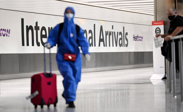 epa08941888 A Traveller arrives at Heathrow Airport in London, Britain, 16 January 2021. The UK government is implementing a closure on all travel corridors from Monday 18 January 2021. Travellers will also need to provide a negative coronavirus test to enter the country. Britain's national health service (NHS) is coming under sever pressure as Covid-19 hospital admissions continue to rise across the UK. Some one thousand people are dying each day from the Covid-19 disease. EPA/ANDY RAIN