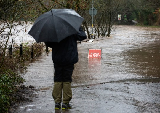 MERCURY PRESS. Gtr Manchester, UK. 20.1.21. Pictured: A man watches flood water rise at a flooded road by the River Mersey in Didsbury, Greatear Manchester this morning where a red flood warning has been issued.