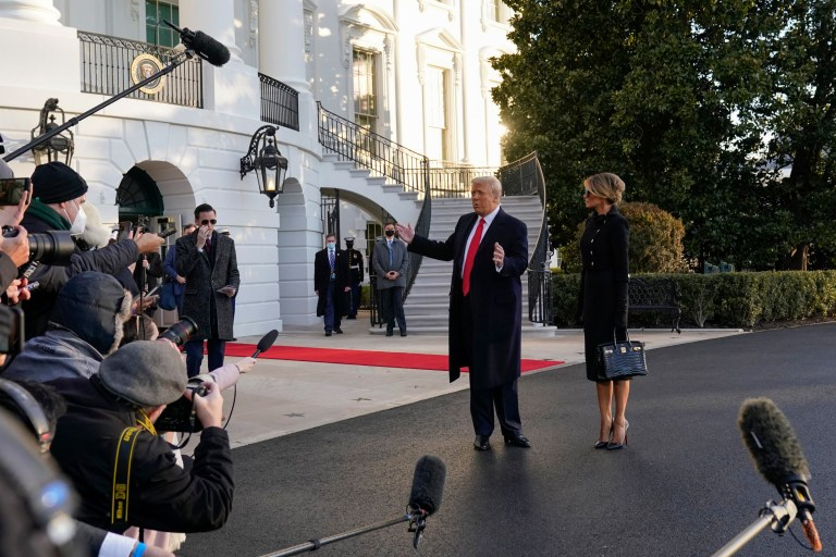 Donald and Melania Trump speaking to reporters