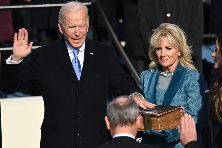 Joe Biden (L), flanked by incoming US First Lady Jill Biden is sworn in as the 46th US President by Supreme Court Chief Justice John Roberts on January 20, 2021, at the US Capitol in Washington, DC. (Photo by SAUL LOEB / POOL / AFP) (Photo by SAUL LOEB/POOL/AFP via Getty Images)