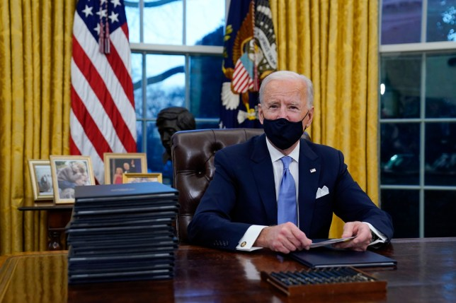 Joe Biden at his Oval Office desk