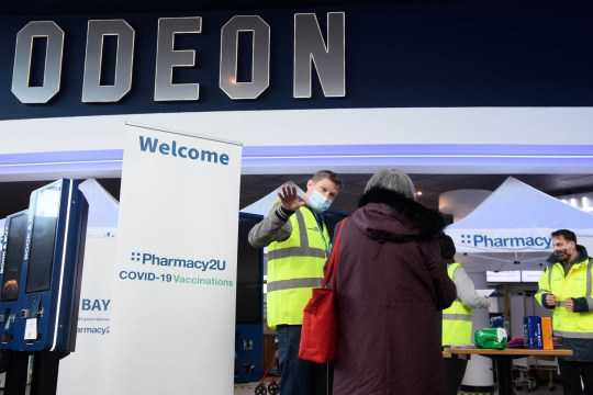 EDITORIAL USE ONLY People arrive to receive the Oxford/AstraZeneca vaccine at the opening of the first Pharmacy2U Covid-19 vaccination centre at the Odeon Cinema in Aylesbury. PA Photo. Picture date: Thursday January 21, 2021. The online pharmacy has partnered with Odeon Cinemas, Morrisons and Village Hotels to open a further three centres in Liverpool, Wakefield and Leeds, with more sites due to be announced as part of the mass vaccination roll-out programme. Photo credit should read: Jonathan Hordle/PA Wire