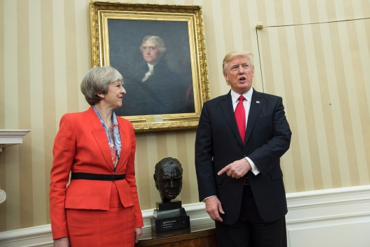 British Prime Minister Theresa May (L) and US President Donald Trump meet beside a bust of former British Prime Minister Winston Churchill in the Oval Office of the White House on January 27, 2017 in Washington, DC. / AFP / Brendan Smialowski (Photo credit should read BRENDAN SMIALOWSKI/AFP via Getty Images)