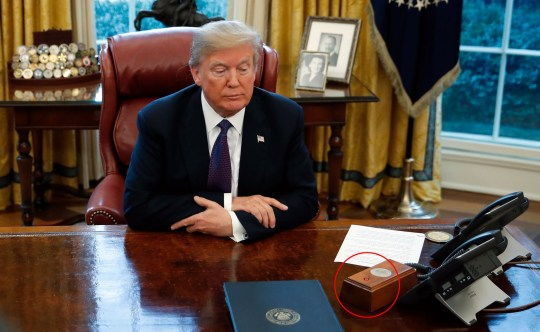 ***Diet Coke button circled*** President Donald Trump sits at the Resolute Desk after signing Section 201 actions in the Oval Office of the White House in Washington, Tuesday, Jan. 23, 2018. (AP Photo/Carolyn Kaster)