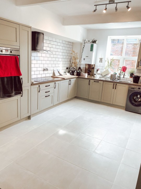 the kitchen with its new tiles and painted floor