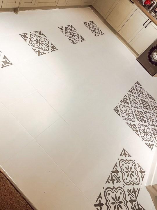 Rachel Marston painting her kitchen floor tiles
