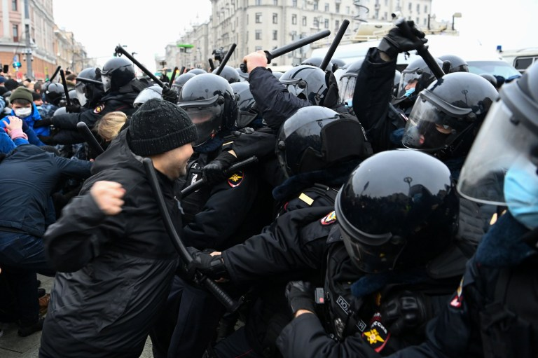 Protesters clash with riot police during a rally in support of jailed opposition leader Alexei Navalny in downtown Moscow on January 23, 2021. - Navalny, 44, was detained last Sunday upon returning to Moscow after five months in Germany recovering from a near-fatal poisoning with a nerve agent and later jailed for 30 days while awaiting trial for violating a suspended sentence he was handed in 2014. (Photo by Kirill KUDRYAVTSEV / AFP) (Photo by KIRILL KUDRYAVTSEV/AFP via Getty Images)