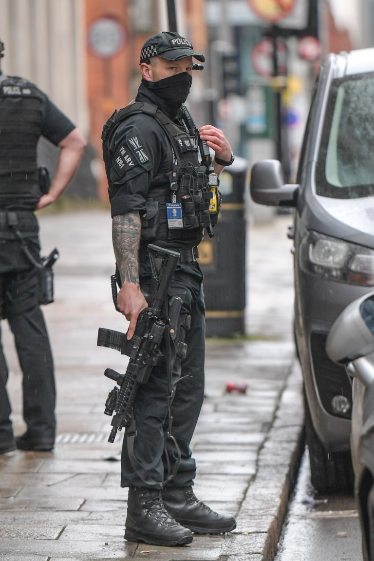 **Moving Footage with relevant desk - Number plates may need pixelating** Pic by SnapperSK - (Pictured: West Midlands Police firearms officers arrested 3 men in Birmingham city centre this morning after a violent dissorder 4 miles away that involved a man who was attacked with a machete. Several cops, one heavily armed with a rifle, cuffed the men on Newhall Street at around 11.20am. Two of the men who were shirtless, were given survival blankets before all 3 were taken away for questioning. One man was seen with blood on his hands whilst another gave 2 thumbs up to the camera as he was led away by police. Pic taken 26/01/2021) - ARMED cops arrested two bare-chested suspects in a dramatic swoop linked to a 'machete' attack four miles away. Police rounded up the shirtless men in Birmingham city centre - after a street brawl saw men 'running around' and 'covered in blood'. The bloodied pair - one of whom was shoeless - were led away draped in orange blankets after their car was stopped by firearms officers. A third man was also arrested after a silver Citroen C5 car was stopped at gunpoint on Newhall Street shortly after 11am. All three men were being questioned over violent disorder which broke out in the Washwood Heath area of the city minutes earlier. A West Midlands Police spokesman said: ???We were called to reports of a disorder on Washwood Heath Road, Birmingham shortly before 11am today (26 January).??? Three men, two of which were shirtless, fled the scene and were arrested on Newhall Street shortly after. ???They have been taken to custody for questioning. ???Our investigations are in the early stages to establish the circumstances of this incident and it is not believed anyone was seriously injured in the disorder.??? Witnesses said they saw men ???running around??? and ???covered in blood??? in Washwood Heath Road. One said: ???Moments later police with guns arrived and surrounded a house. ???They have recovered a machete but they are still looking for a g