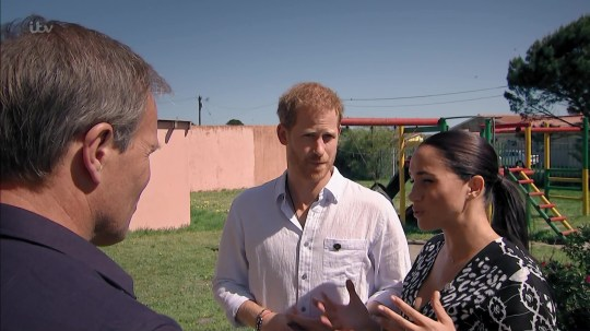 Harry and Meghan speaking to Tom Bradbury