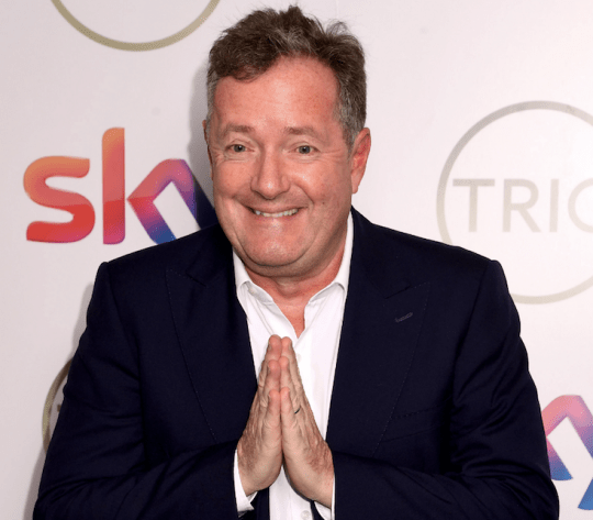 Good Morning Britain presenter Piers Morgan looks on