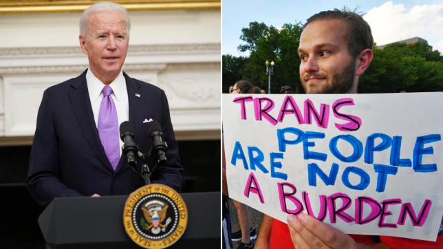 Man in suit behind mic stand next to man holding up sign supporting transgender rights