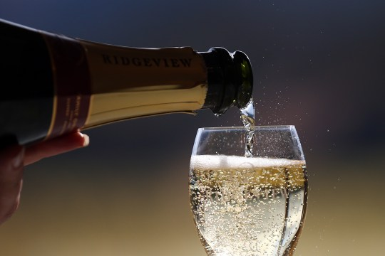 Bottle of sparkling wine being poured