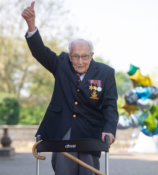 File photo dated 16/04/2020 of the then 99-year-old war veteran Captain Tom Moore at his home in Marston Moretaine, Bedfordshire, after he achieved his goal of 100 laps of his garden. Captain Sir Tom Moore has died at the age of 100 after testing positive for Covid-19, his daughters Hannah and Lucy said in a statement. Issue date: Tuesday February 2, 2021. PA Photo. See PA story DEATH CaptainTom. Photo credit should read: Joe Giddens/PA Wire