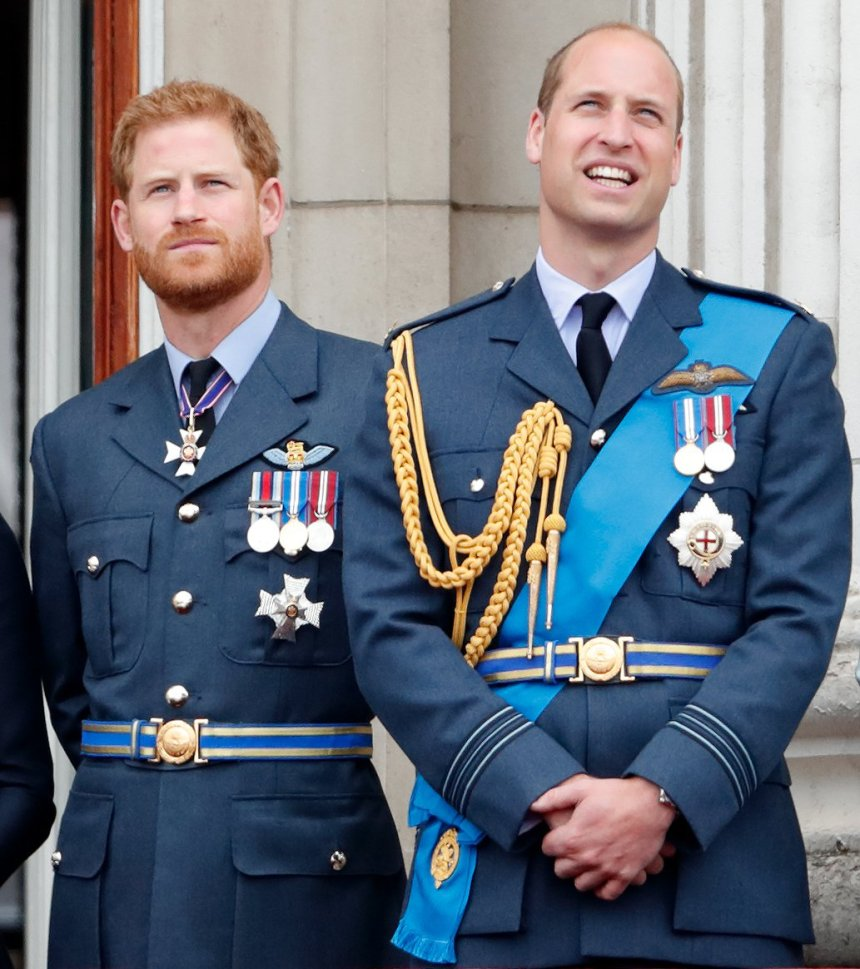 Prince Harry, Duke of Sussex and Prince William, Duke of Cambridge watch a flypast to mark the centenary of the Royal Air Force from the balcony of Buckingham Palace. Prince William is said to be upset over Harry and Meghan's 'insulting' response to the Queen about service.