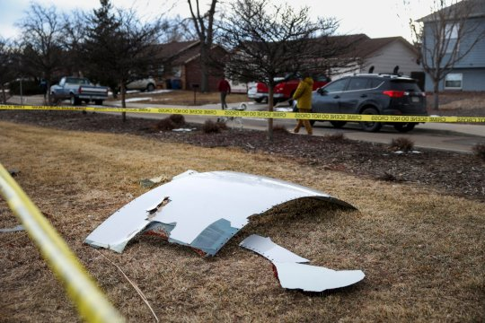 Pieces of an airplane engine from Flight 328 sit scattered in a neighbourhood on February 20