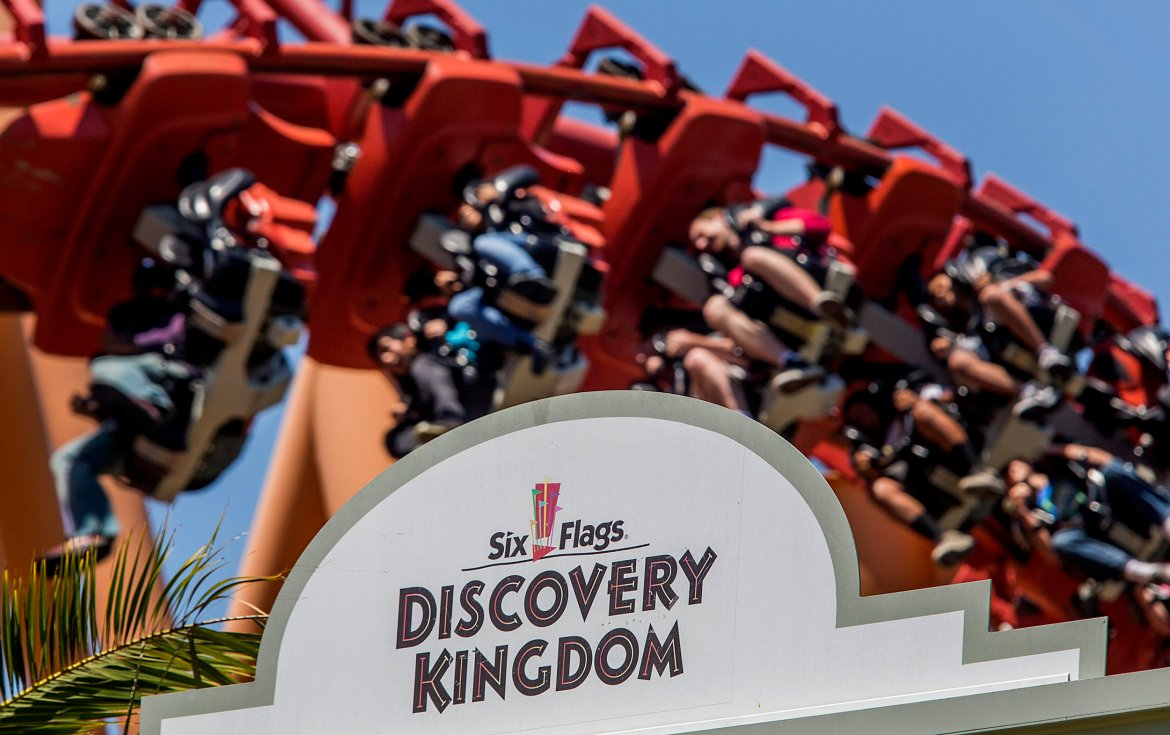 People on red rollercoaster at Six Flags Discover Kingdom