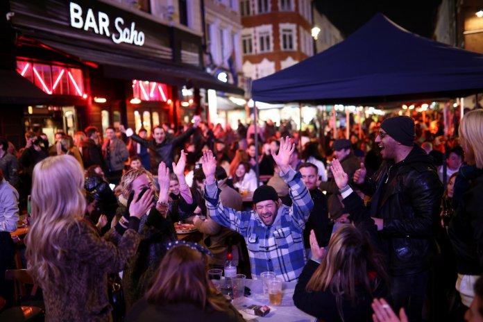 Joyful scenes on the terrace of a bar in Soho