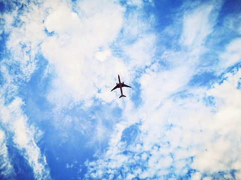 A low angle view of an airplane flying in the sky