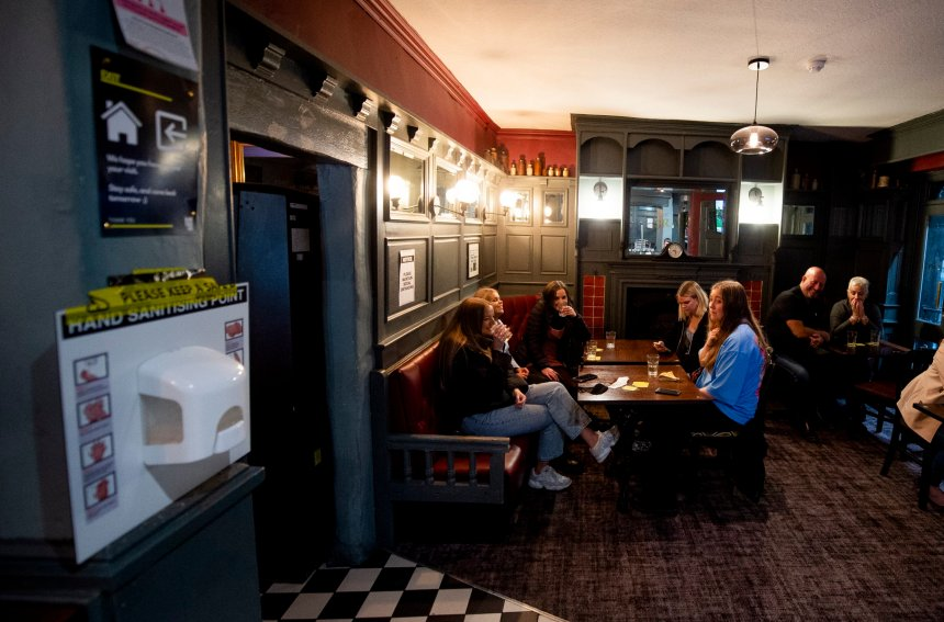 People enjoy their last drink in the Grapes Pub on Mathew Street a night before a local lockdown amidst the spread of the coronavirus disease (Covid 19) in Liverpool, Britain, 14 October 2020.