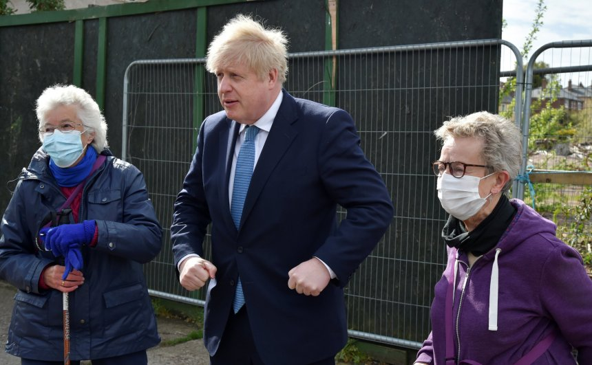British Prime Minister Boris Johnson meets with Jan Pritchard, left, and Maggie Bickett, near the Stourbridge canal in the West Midlands during a Conservative party local election visit, in Stourbridge, Britain May 5, 2021. Rui Vieira/Pool via REUTERS