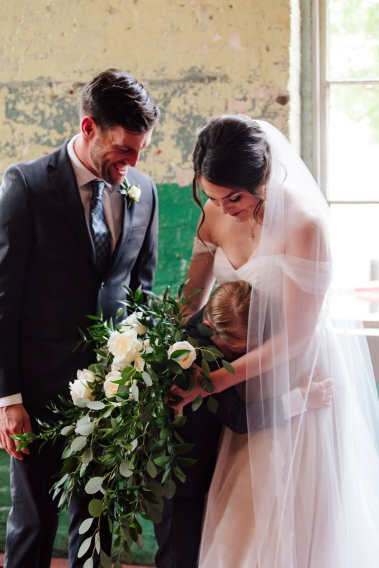 These images show the delightful moment that ten-year-old Jew Seabolt burst into tears after seeing his new stepmother Rebekah Seabolt in her wedding dress at her wedding to his father Tyler Seabolt.  Monroe, Georgia, USA.