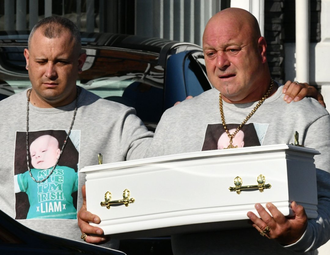 Alan Lewis - PhotopressBelfast.co.uk 4-8-2021 Liam O???Keefe carries the coffin of his two month-old baby Liam on their way to Roselawn Crematorium on Wednesday morning from Brown???s Funeral parlour in north Belfast. The baby died in a tragic incident last week and his mother has been charged with murdering the child and the attempted murder of his little sister who is in a stable condition after being taken to hospital critically ill.