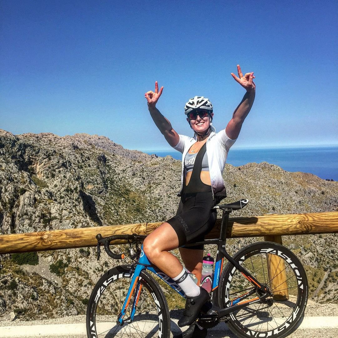 Olivia Podmore smiles as she cycles