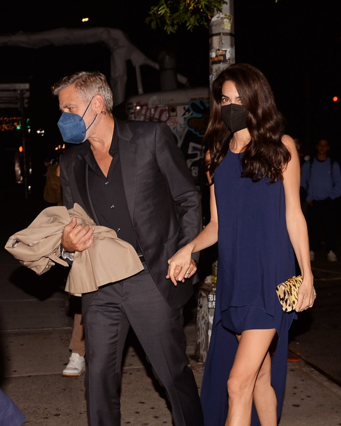 George Clooney takes his wife Amal Clooney out for dinner holding hands in Soho New York City after promoting his new movie The Tender Bar