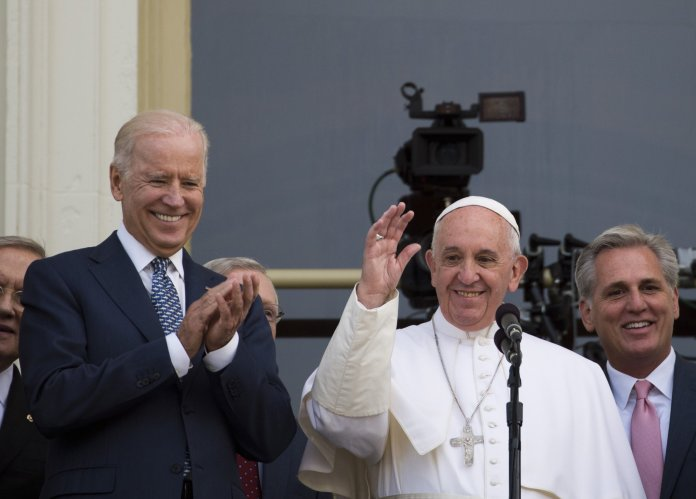 President Joe Biden (left) will meet with Pope Francis (center) in Vatican City during the G20 Leaders' Summit at the end of October