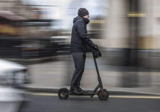 GENERIC SCENES E-SCOOTER RIDERS / LONDON, ENGLAND - JANUARY 9: A man passes past Parliament Square on an electric scooter on January 9, 2019 in London, England. In the UK, electric scooters and similar powered transporters are still classified as 'motor vehicles,' subject to the same regulations. This makes them illegal to operate in pedestrian areas and bicycle lanes, and imposes strict licensing requirements on potential road use. Despite the current prohibitive regulations, many commuters have turned towards scooters as an alternative mode of travel. (Photo by Dan Kitwood/Getty Images)
