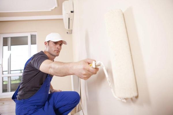 a man roller painting the wall - Metro Boston Property Inspection - home improvement