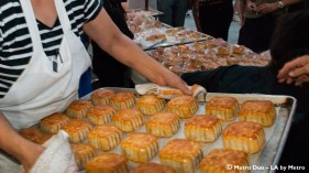 woman holds tray for baked sweet pastries
