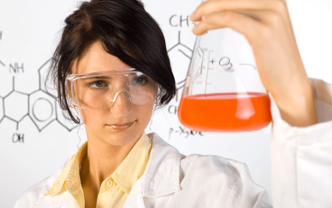 Female chemist with Erlenmeyer Flask