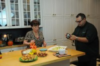 Helga looks on while 'Homeplate' co-producer Ron Flaviano photographs the food