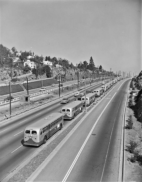 Caravan of new buses through Cahuenga Pass