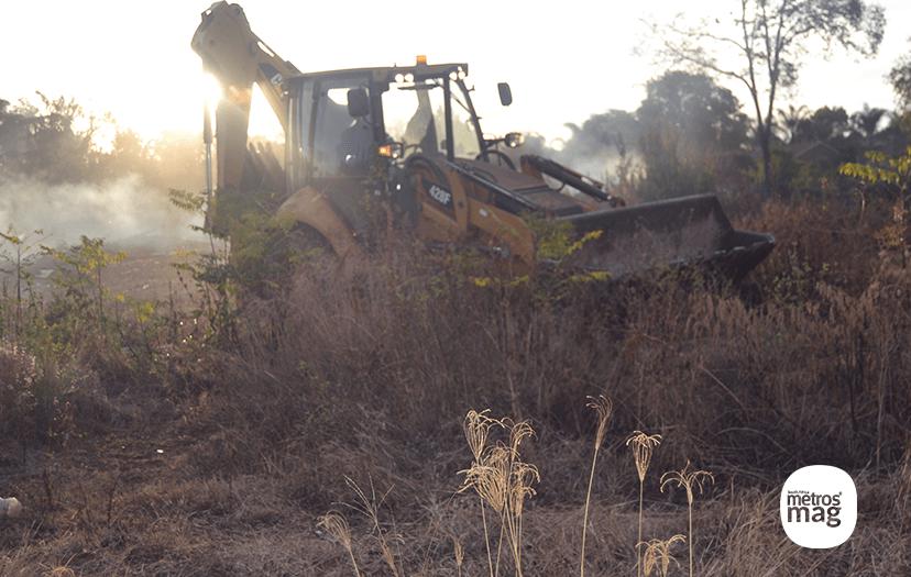 catapillar doing ploughing the wreckages