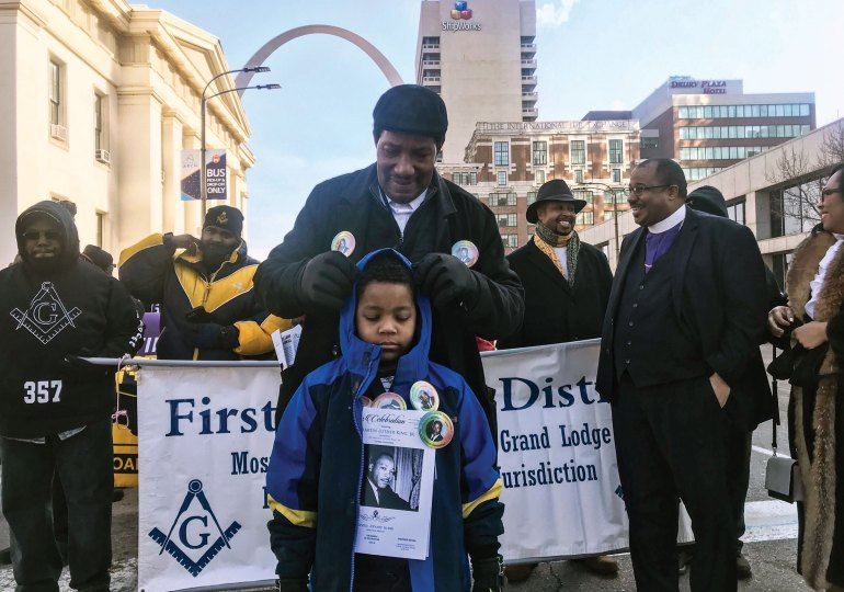 Speakers, marchers honor MLK