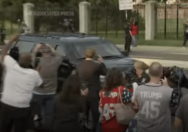 Trump takes drive outside hospital to wave to fans; doctor calls move 'insanity'