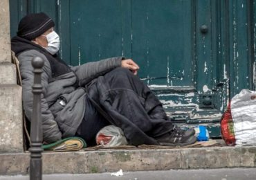 Surging virus, deep cold challenge homeless shelters