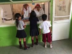 Getting morning snack from JUNAEB school feeding program
