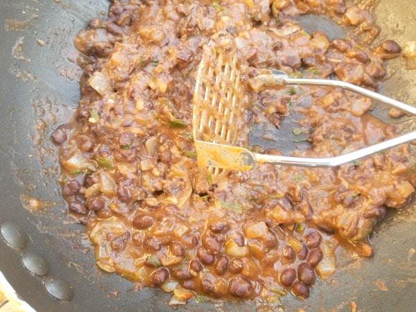 Mash black beans some for the Crispy Black Bean Tacos.