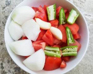 Tomatoes, onions, garlic and serrano peppers for the tomato puree for the Morisquesta