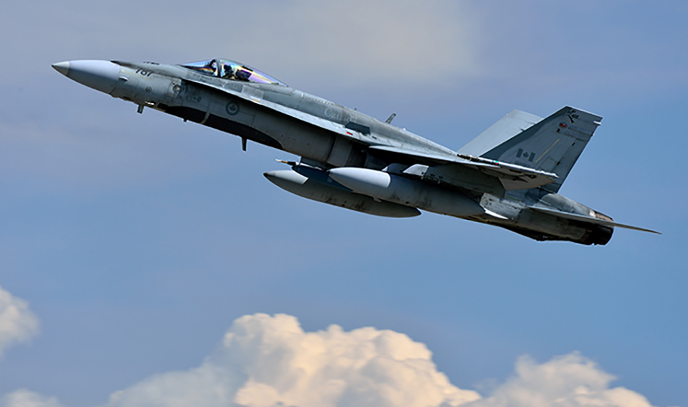 A Royal Canadian Air Force CF-188 Hornet fighter aircraft takes off during Exercise MAPLE FLAG 2013 (JOINTEX 13), at Canadian Forces Base Cold Lake in Cold Lake, Alberta on May 27, 2013. Photo : MCpl Marc-André Gaudreault, Canadian Forces Combat Camera Un chasseur CF188 Hornet de l'Aviation royale canadienne décolle de la Base des Forces canadiennes Cold Lake, à Cold Lake (Alberta), le 27 mai 2013, dans le cadre de l'exercice Maple Flag 2013 (JOINTEX 13).    Photo : Cplc Marc-André Gaudreault, Caméra de combat des Forces Canadiennes IS2013-2001-016