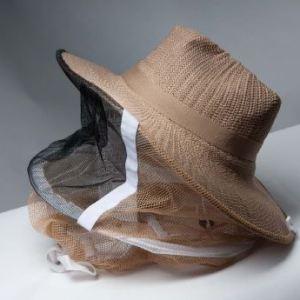 straw hat with round veil