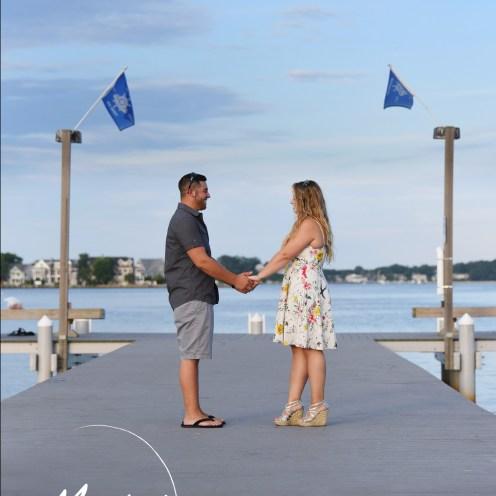 holding hands on a bridge