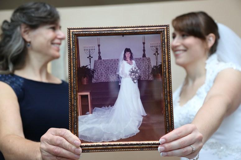 daughter wearing mothers wedding dress