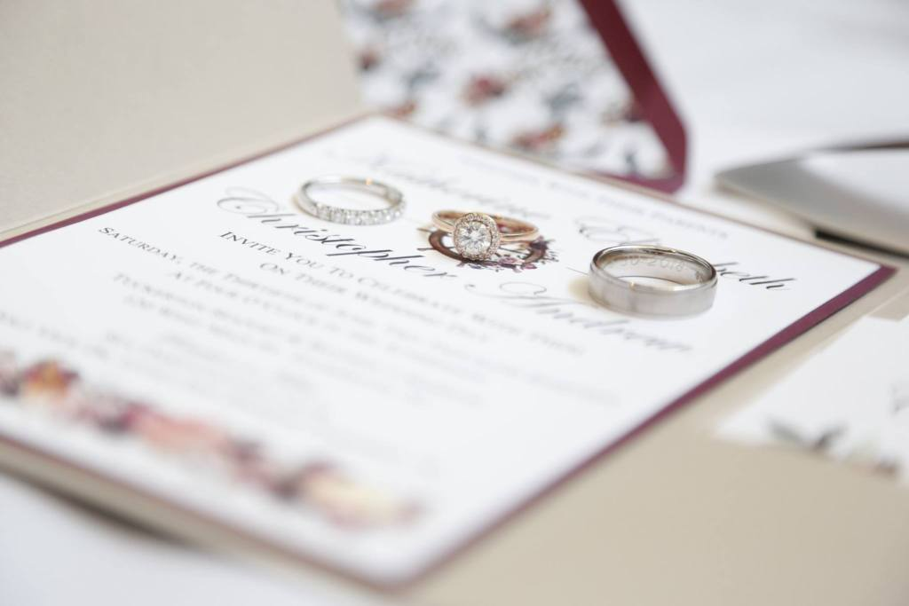 beach themed wedding invitation and rings